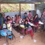 Pupils in tin hut classrooms