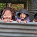 Children of the village in their tin hut classrooms, waiting for the school to reopen